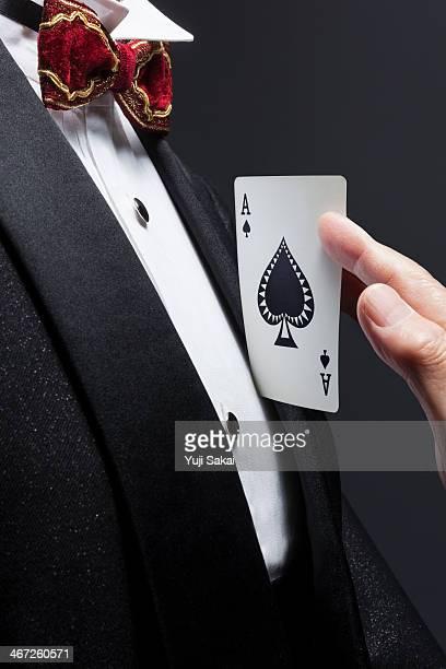 wearing Tuxedo  man holding  Spade A