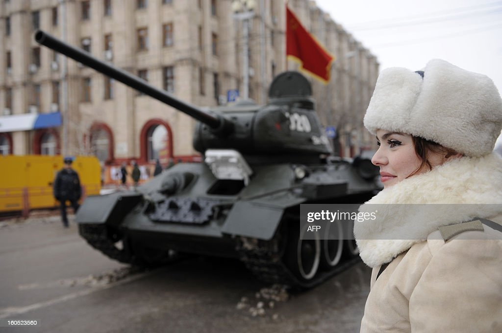 Wearing World War II-era Red Amy winter clothes a girl watches a T-34-85 tank rolling during a military parade marking the 70th anniversary of the Stalingrad Battle, in the Russian city of Volgograd, formerly Stalingrad, on February 2, 2013, . Russia marked today the 70th anniversary of a brutal battle in which the Red Army defeated Nazi forces and changed the course of World War II.