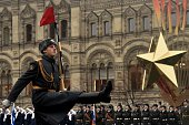 Wearing World War IIera uniform of the Red Army troops Russian soldiers take part in the military parade on the Red Square in Moscow on November 7...