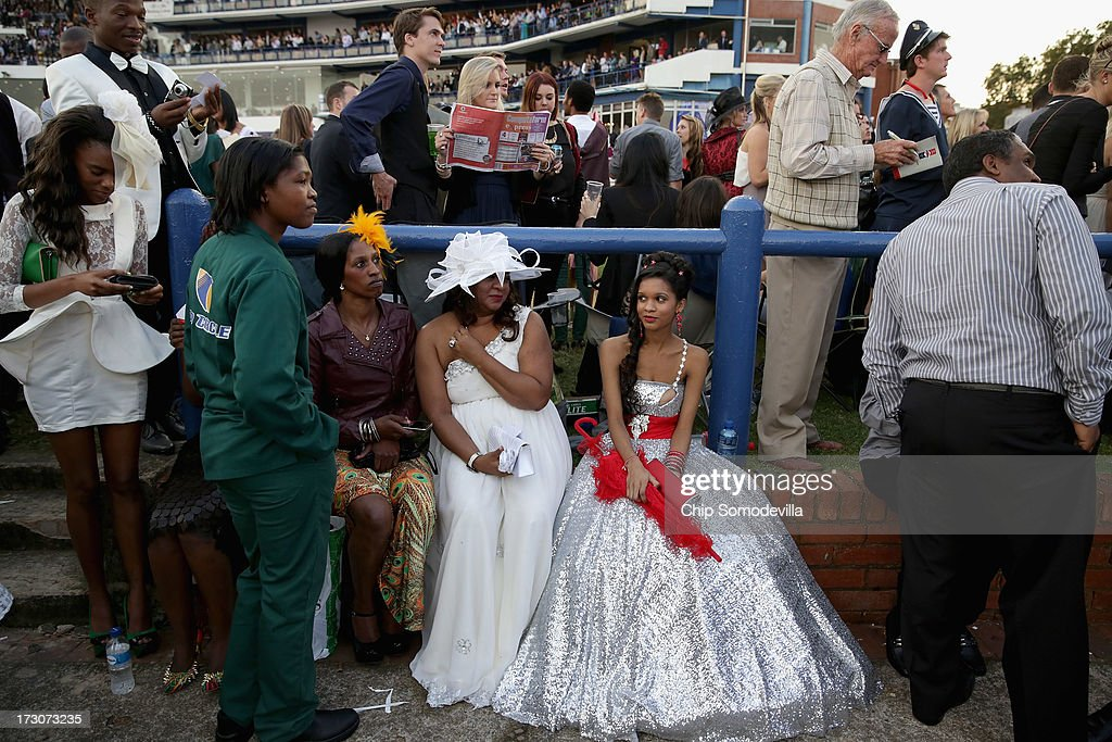 Weary racegoers take a break at the winning posts picnic site during the Durban July horse races July 6, 2013 in Durban, South Africa. South Africa's premier horse racing event, the 2200-meter Durban July is held annually on the first Saturday of July since 1897 and offers a purse of 2.5 million Rand or about US $245,000.