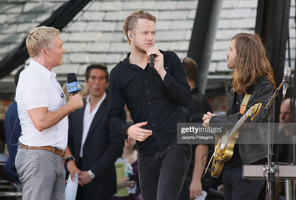 Weather Anchor Sam Champion interviews Dan Reynolds and Wayne Sermon of Imagine Dragons at ABC's 'Good Morning America' at Rumsey Playfield, Central Park on July 5, 2013 in New York City.