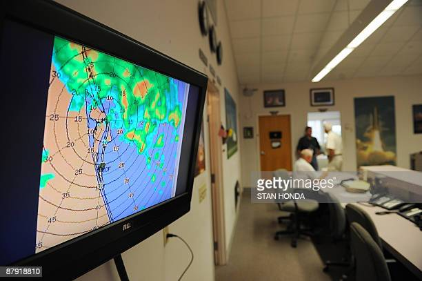 A weather map showing nearby thunder storms May 22 2009 in the media center at Kennedy Space Center in Florida as NASA waves off the landing of the...
