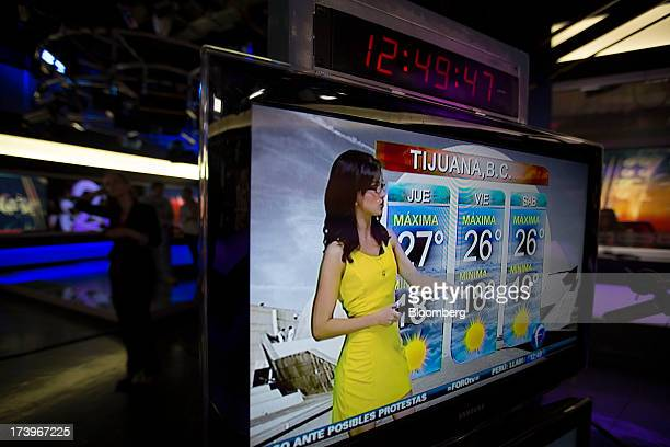 A weather presenter gives the forecast for Tijuana on Grupo Televisa SAB's FOROtv news channel at the Televisa studios in Mexico City Mexico on...