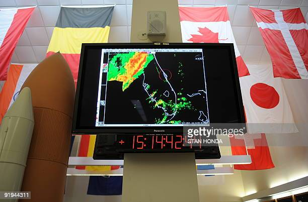 A weather radar map on NASA television November 30 2008 in the media center at Kennedy Space Center in Florida as both landing attempts of the space...