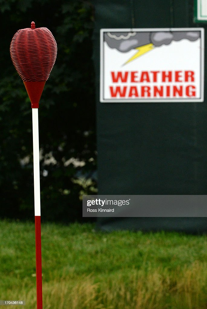 A weather warning sign is seen near the first green during Round One of the 113th US Open at Merion Golf Club on June 13 2013 in Ardmore Pennsylvania