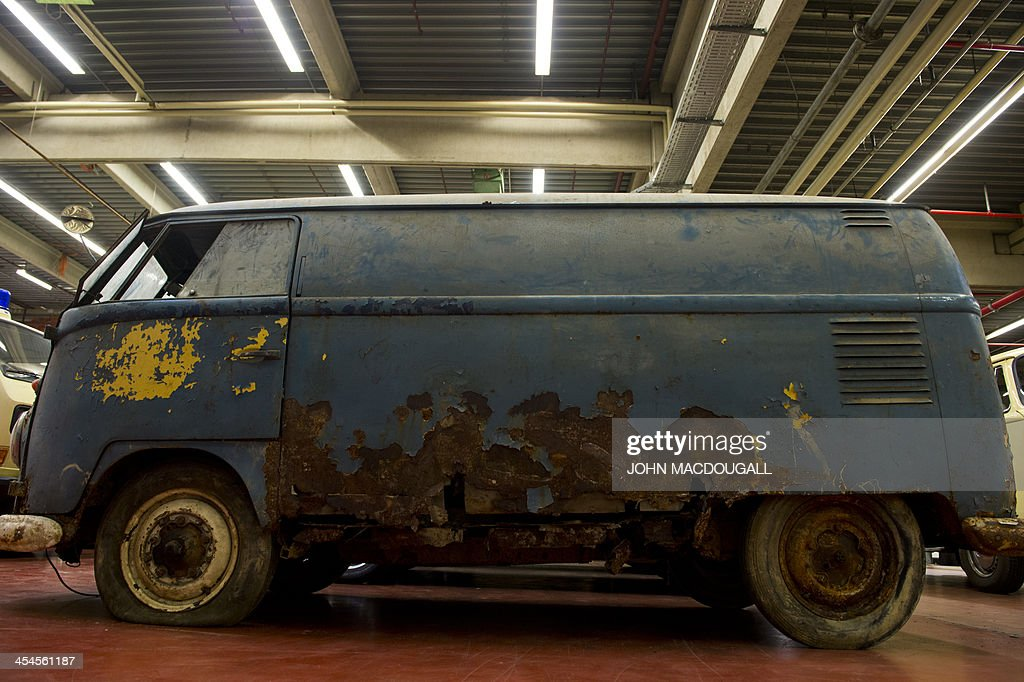A weatherbeaten Volkswagen T1 van built in 1951 is on display at a Volkswagen workshop specialised in restoring vintage T1, T2, T3 and T4 (Transporter) vans, in Hanover on December 9, 2013. The workshop handles vintage vehicles for VW, and private clients alike. A complete makeover of a badly damaged van can cost up to EUR