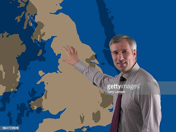 Weathercaster Pointing at Map