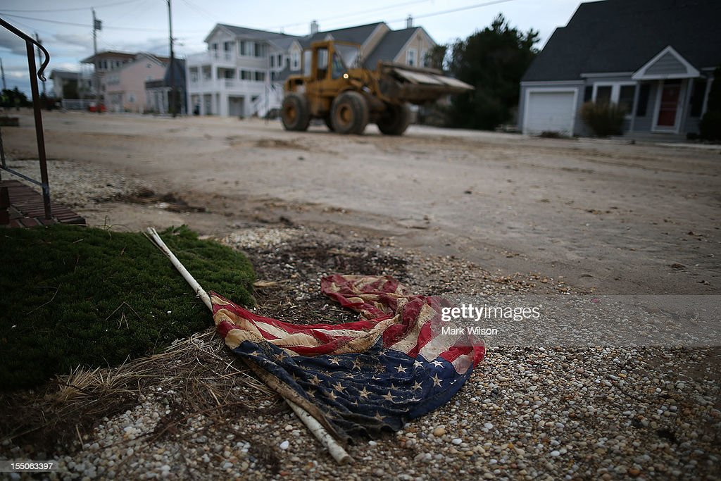 A weathered American flag lies on the road on October 31, 2012 in Long Beach Island, New Jersey. Earlier in the week Hurricane Sandy made landfall on New Jersey coastline bringing heavy winds and record floodwaters.
