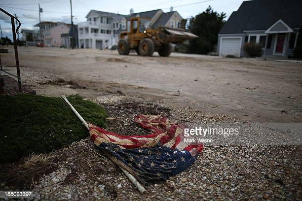 A weathered American flag lies on the road on October 31 2012 in Long Beach Island New Jersey Earlier in the week Hurricane Sandy made landfall on...