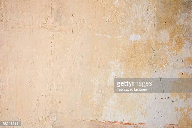 Weathered and aged orange concrete wall background