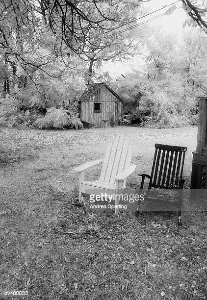 Weathered chairs and rustic shed