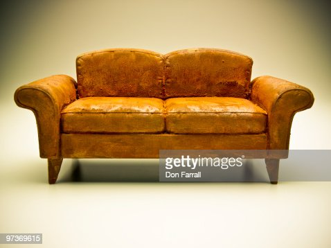 weathered couch : Stock Photo