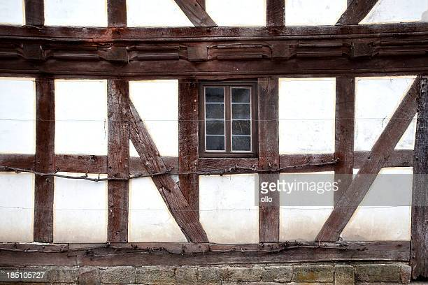 Weathered facade of an old half-timbered house