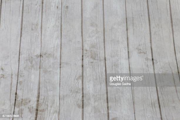 Weathered hardwood floor paneling