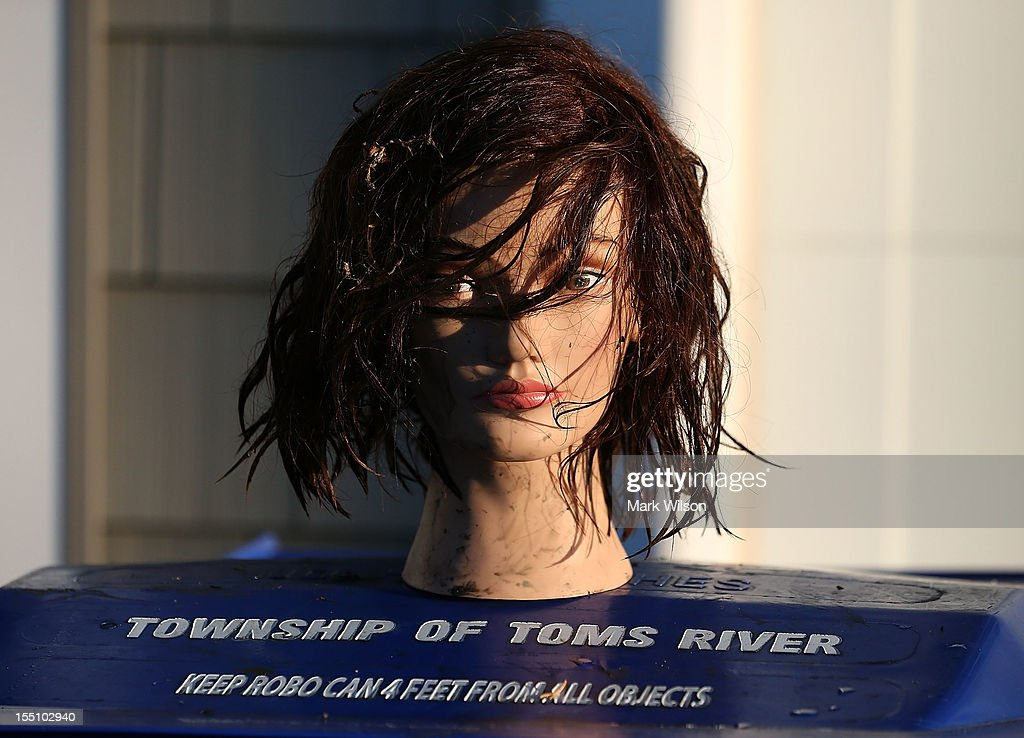 A weathered mannequin head sits on a trash can in front of a home damaged by Superstorm Sandy on November 1, 2012 in Toms River, New Jersey. With the death toll continuing to rise and millions of homes and businesses without power, the U.S. east coast is attempting to recover from the effects of floods, fires and power outages brought on by Superstorm Sandy.