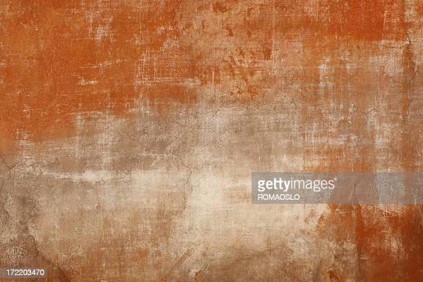 Weathered red wall texture in Rome, Italy