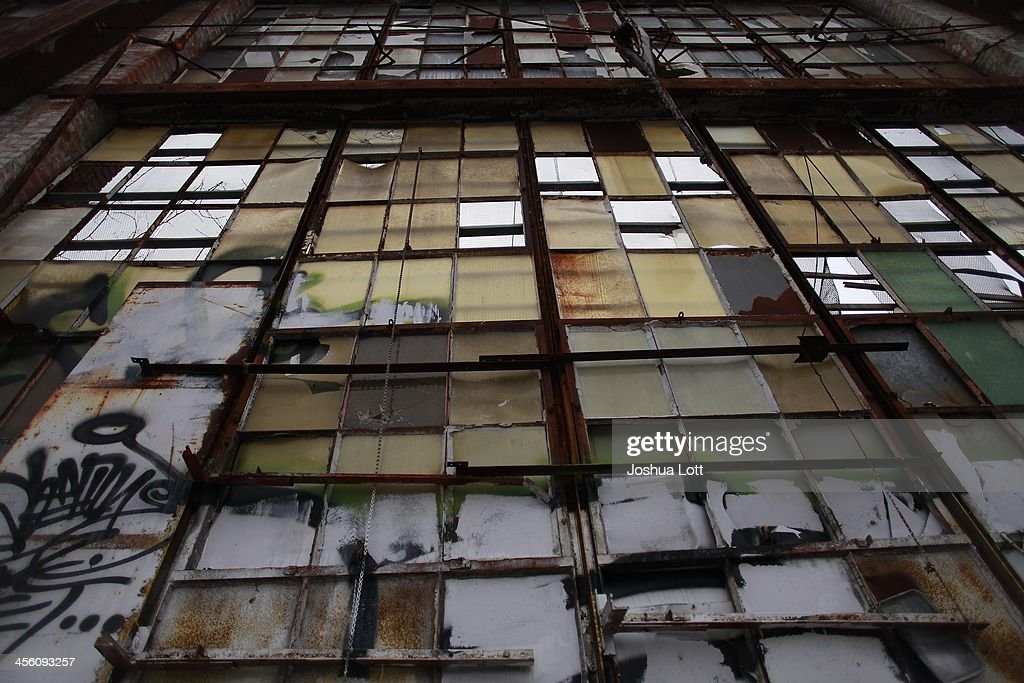 Weathered window panels remain in place at the abandoned Packard Automotive Plant December 13, 2013 in Detroit, Michigan. Peru-based developer Fernando Palazuelo made his final payment on the Packard Plant, which he won during a Wayne County auction for $405,000. Palazuelo plans on developing the former automotive plant where luxury Packard cars were made in the coming years.