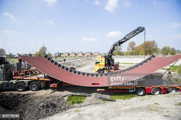 A weathering steel part of the national monument in memory of the victims of disaster flight MH17 is placed in Vijfhuizen on April 20 2017 Malaysia...