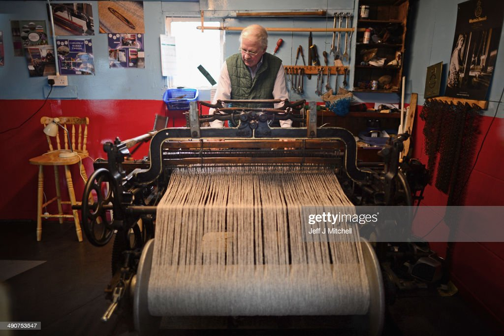 Weaver Norman Mackenzie, works on his Hattersley single width loom in the village of Carloway on May 14, 2014 in Lewis.Sales in one of Scotlands last cottage industries are soaring with Japan, Russia and Germany being some of the largest international importers of the cloth. A referendum on whether Scotland should be an independent country will take place on September 18, 2014.