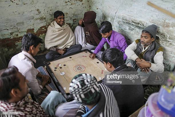 Weavers play carrom in Varanasi Uttar Pradesh India on Thursday Dec 8 2016 Indian Prime Minister Narendra Modi's Nov 8 decision to ban highvalue...