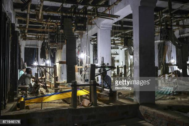 Weavers use handlooms to make silk sarees in a workshop at night in Varanasi Uttar Pradesh India on Friday Oct 27 2017 In Varanasi where the...