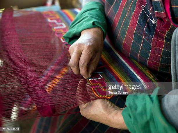Weaving a woollen yathra blanket on a Tibetan style loom in Chumey village Bumthang Central Bhutan Yathra is a hand woven fabric made from the wool...