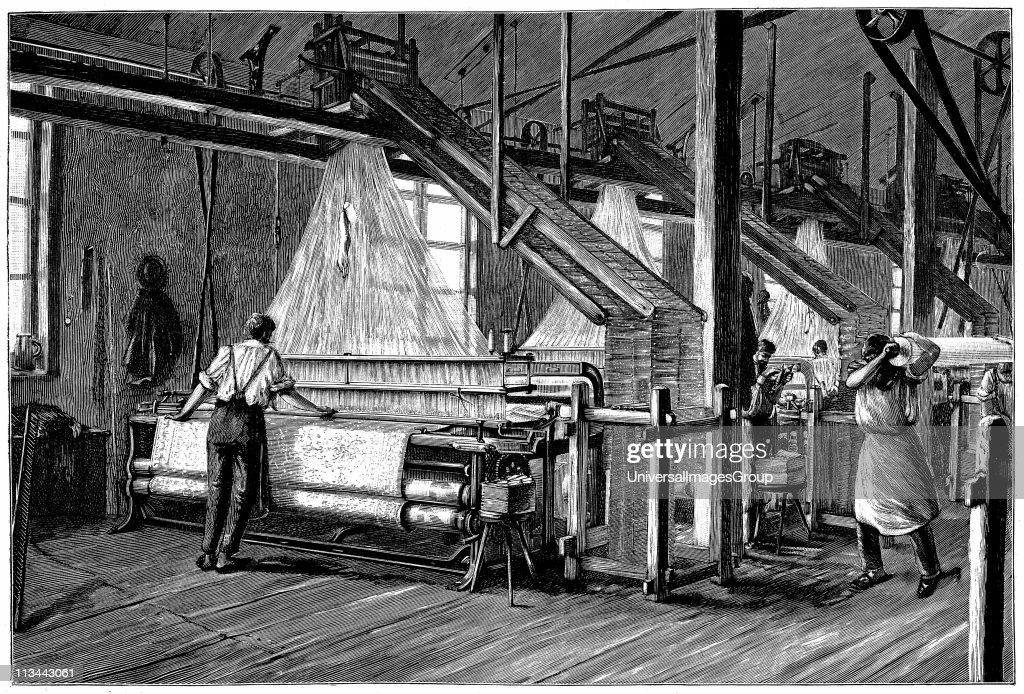 Weaving shed fitted with Jacquard power looms Swags of punched cards carrying pattern being woven are at right and above each loom Illustration Paris...