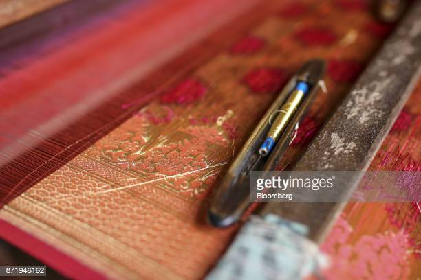 A weaving shuttle sits on an unfinished silk saree at a workshop in Varanasi Uttar Pradesh India on Friday Oct 27 2017 In Varanasi where the...