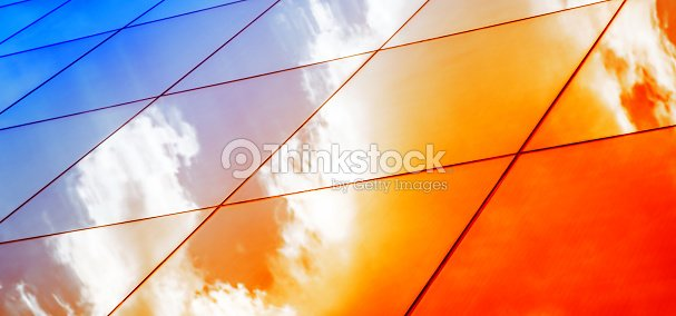 Web banner Modern glass architecture with reflection of red and blue sunset sky. Dramatic bright color. Vintage style background. : Stock Photo