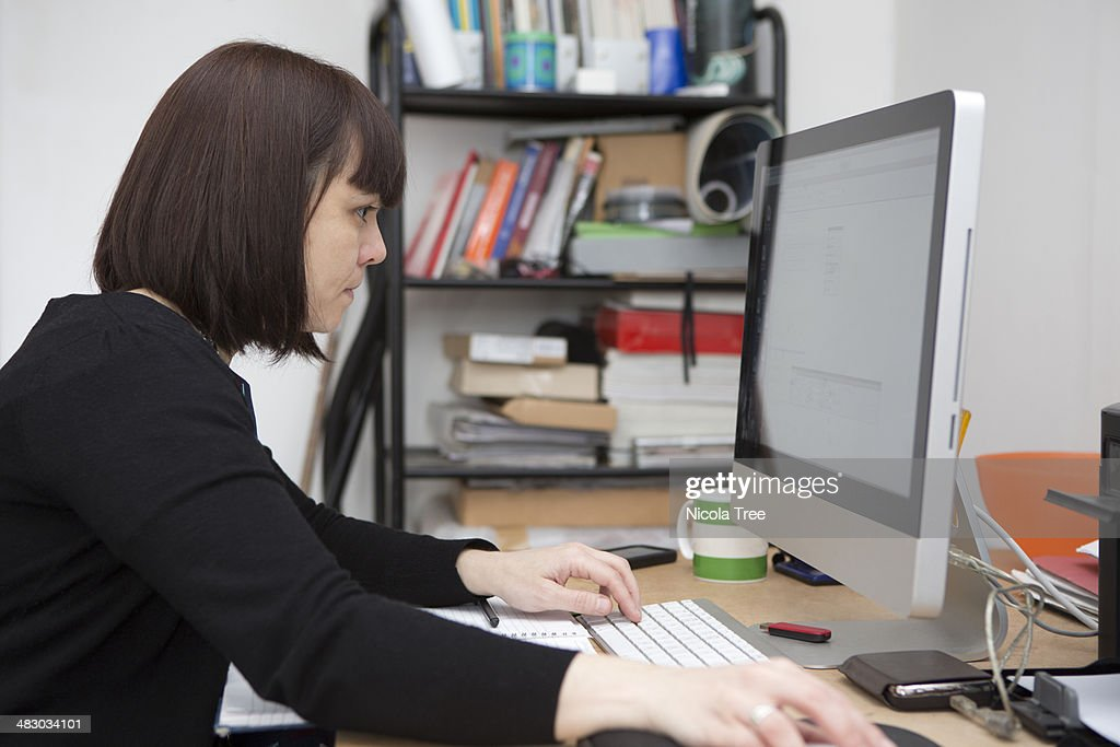 Web designer working in her studio