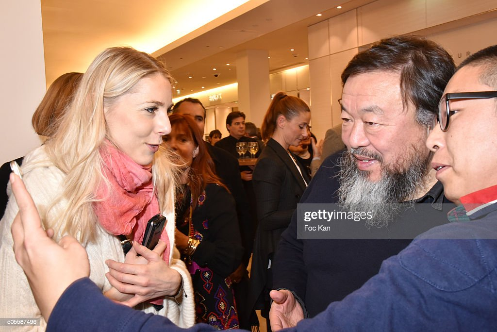 WWD web editor Laure Guilbault (L) and painter/sculptor Ai Weiwei attend the Ai Weiwei Exhibition Preview Cocktail at Le Bon Marche on January 18, 2016 in Paris, France.