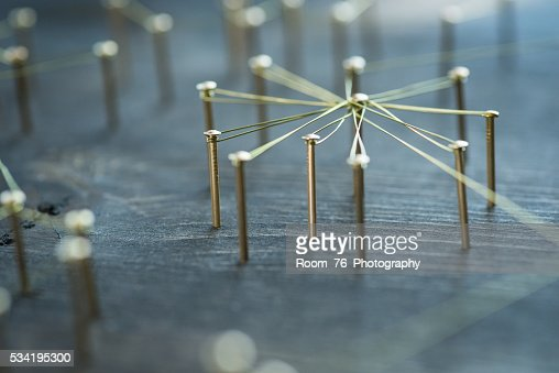 Web of wires, showing connections between groups and singles : Stock Photo