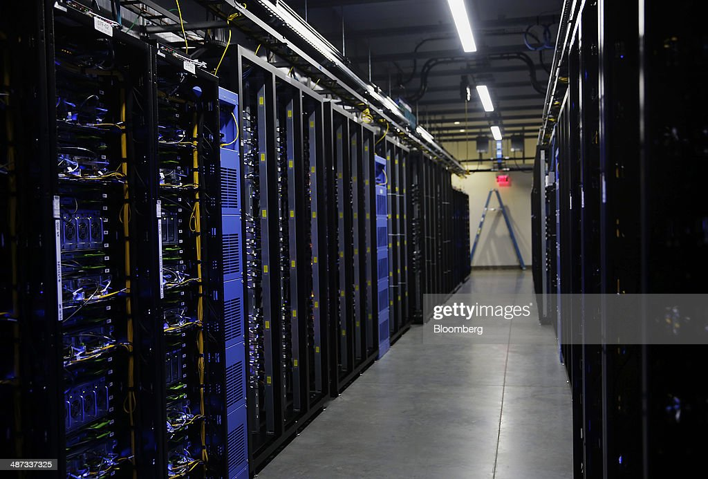 Web servers stand inside the Facebook Inc. Prineville Data Center in Prineville, Oregon, U.S., on Monday, April 28, 2014. The Facebook Prineville Data Center features leading energy-efficient technology, including features such as rainwater reclamation, a solar energy installation for providing electricity to the office areas and reuse of heat created by the servers to heat office space. Photographer: Meg Roussos/Bloomberg via Getty Images