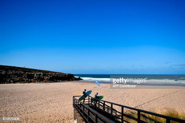 Web Summit attendees arrive with their surfboards for a surf lesson at Foz do Lizandro beach in Ericeira on November 5 2017 during a 2017 Web Summit...