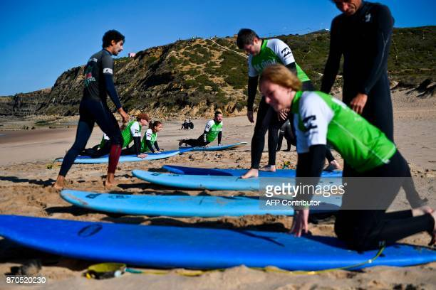 Web Summit attendees attend a surf lesson at Foz do Lizandro beach in Ericeira on November 5 2017 during a 2017 Web Summit surf event for attendees...