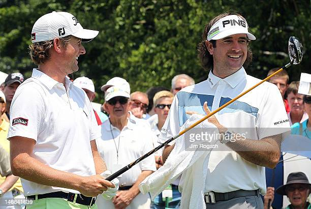 Webb Simpson and Bubba Watson chat on the 1st tee box during Round One of the 2012 Travelers Championship at TPC River Highlands on June 21 2012 in...