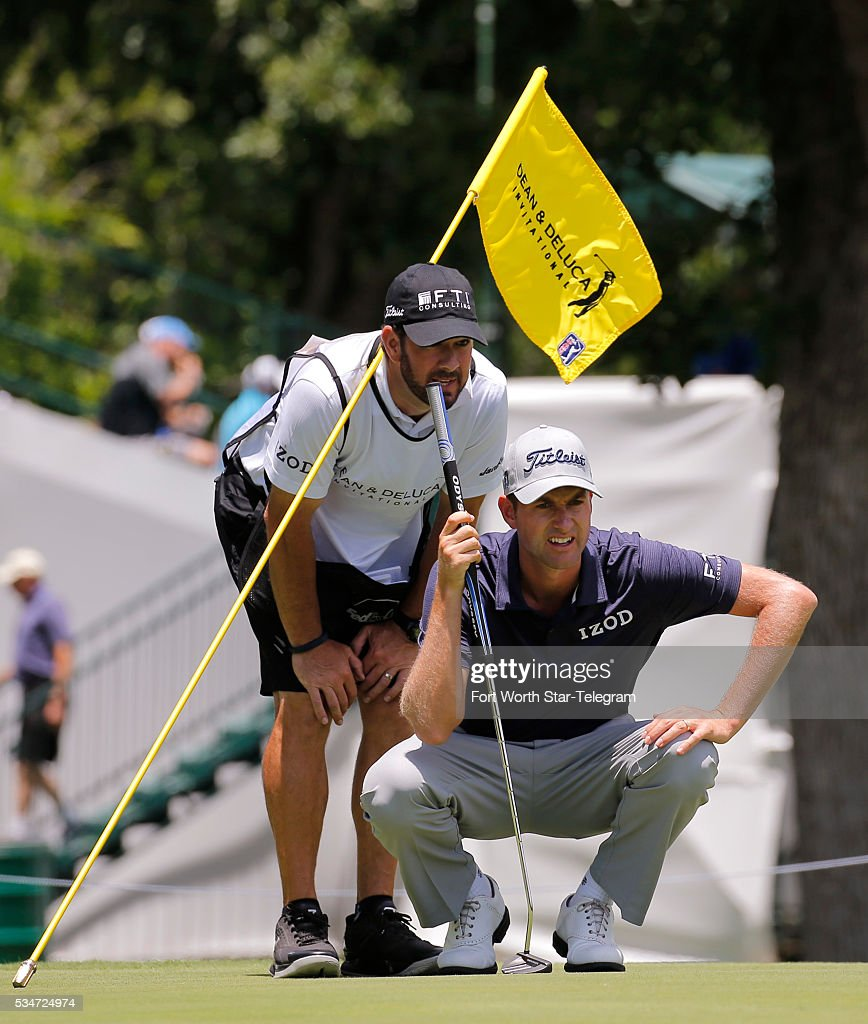 Webb Simpson and caddie Paul Tesori study a putt on the second green during the second day of the Dean & DeLuca Invitational Golf Tournament at the Colonial Country Club on May 27, 2016 in Fort Worth, Texas.