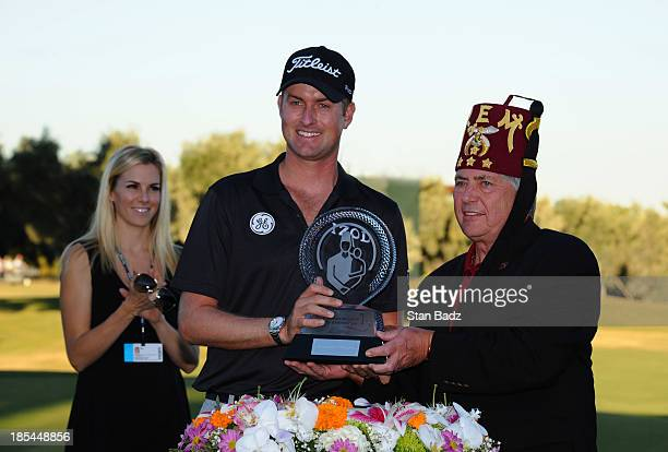 Webb Simpson and Dale Stauss Deputy Imperial Potentate of Shriners Hospitals for Children pose with the winner's trophy on the 18th green during the...