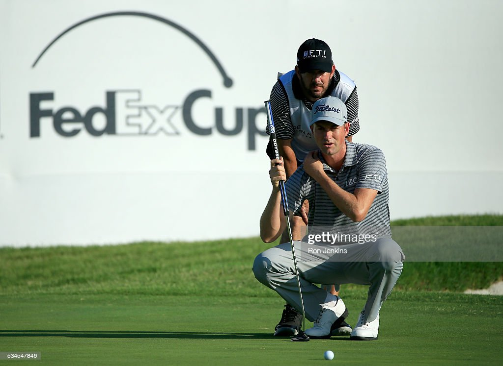<a gi-track='captionPersonalityLinkClicked' href=/galleries/search?phrase=Webb+Simpson&family=editorial&specificpeople=4466575 ng-click='$event.stopPropagation()'>Webb Simpson</a> and his caddie line up a putt on the ninth green during the First Round of the DEAN & DELUCA Invitational at Colonial Country Club on May 26, 2016 in Fort Worth, Texas.