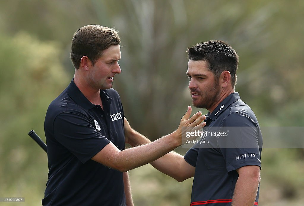 Webb Simpson and Louis Oosthuizen of South Africa shake hands during the third round of the World Golf Championships - Accenture Match Play Championship at The Golf Club at Dove Mountain on February 21, 2014 in Marana, Arizona.