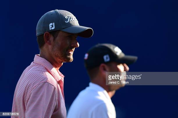 Webb Simpson and Ryan Armour walk off the 18th green after the third round of the Wyndham Championship at Sedgefield Country Club on August 19 2017...