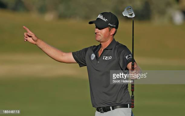 Webb Simpson celebrates after making birdie on the 18th hole on his way to a sixstroke victory during the final round of the Shriners Hospitals for...