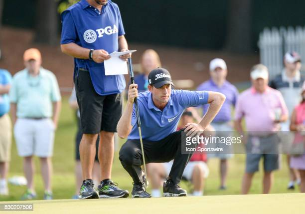 Webb Simpson eyes his putt on the 10th green during 2nd round action at the PGA Championship at the Quail Hollow Club on August 11 2017 in Charlotte...