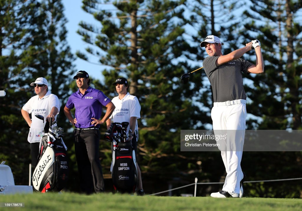 Webb Simpson (R) hits a tee shot on the third hole as Scott Piercy (second from left) looks on during the final round of the Hyundai Tournament of Champions at the Plantation Course on January 8, 2013 in Kapalua, Hawaii.