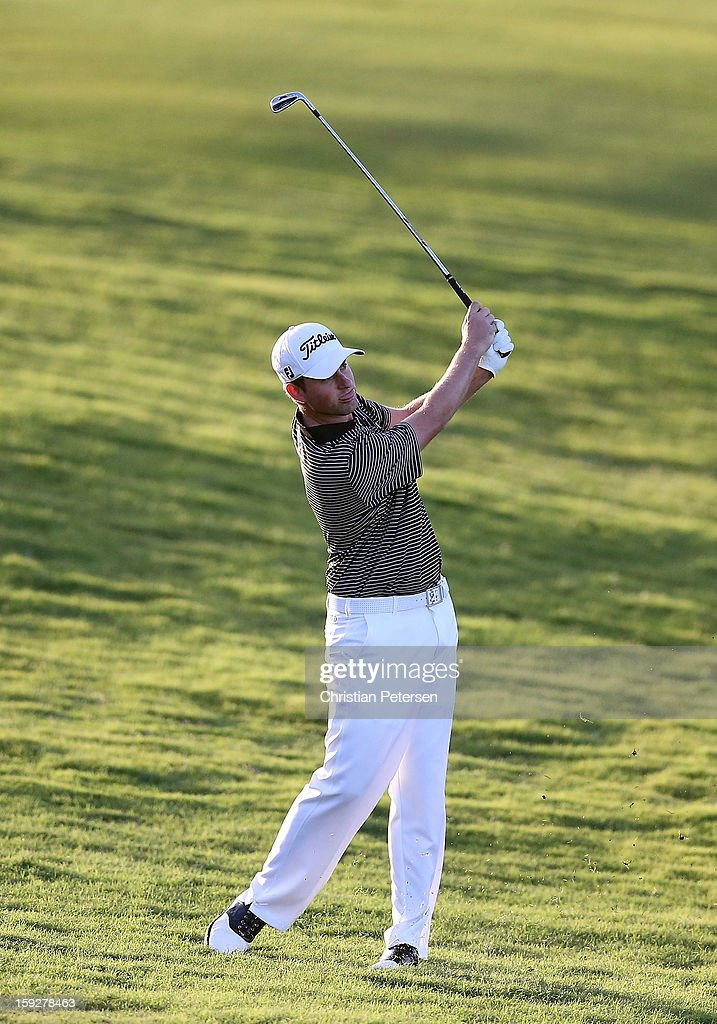 Webb Simpson hits his second shot on the first hole during the final round of the Hyundai Tournament of Champions at the Plantation Course on January 8, 2013 in Kapalua, Hawaii.