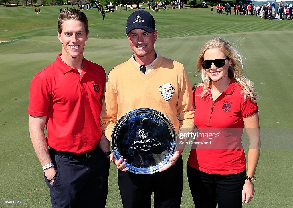 Webb Simpson holds the Payne Stewart Award presented by Aaron Stewart (L) and Chelsea Stewart following the second day of the Tavistock Cup at the Isleworth Golf and Country Club on March 26, 2013 in Windermere, Florida.