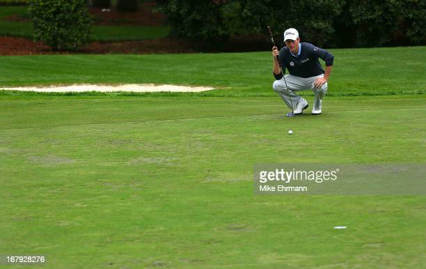 Webb Simpson lines up a putt on the 13th hole during the first round of the Wells Fargo Championship at Quail Hollow Club on May 2 2013 in Charlotte...