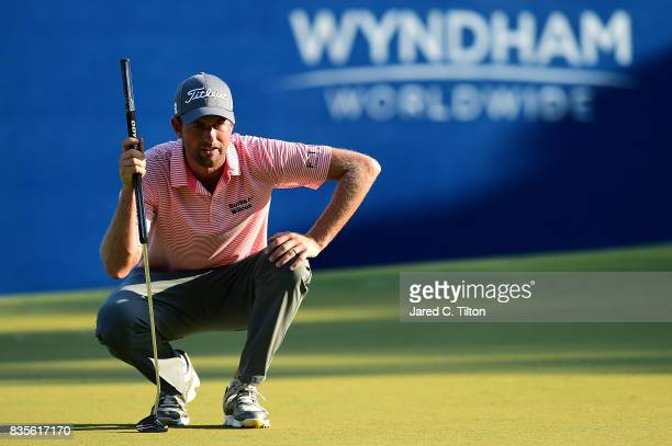 Webb Simpson lines up a putt on the 18th green during the third round of the Wyndham Championship at Sedgefield Country Club on August 19 2017 in...