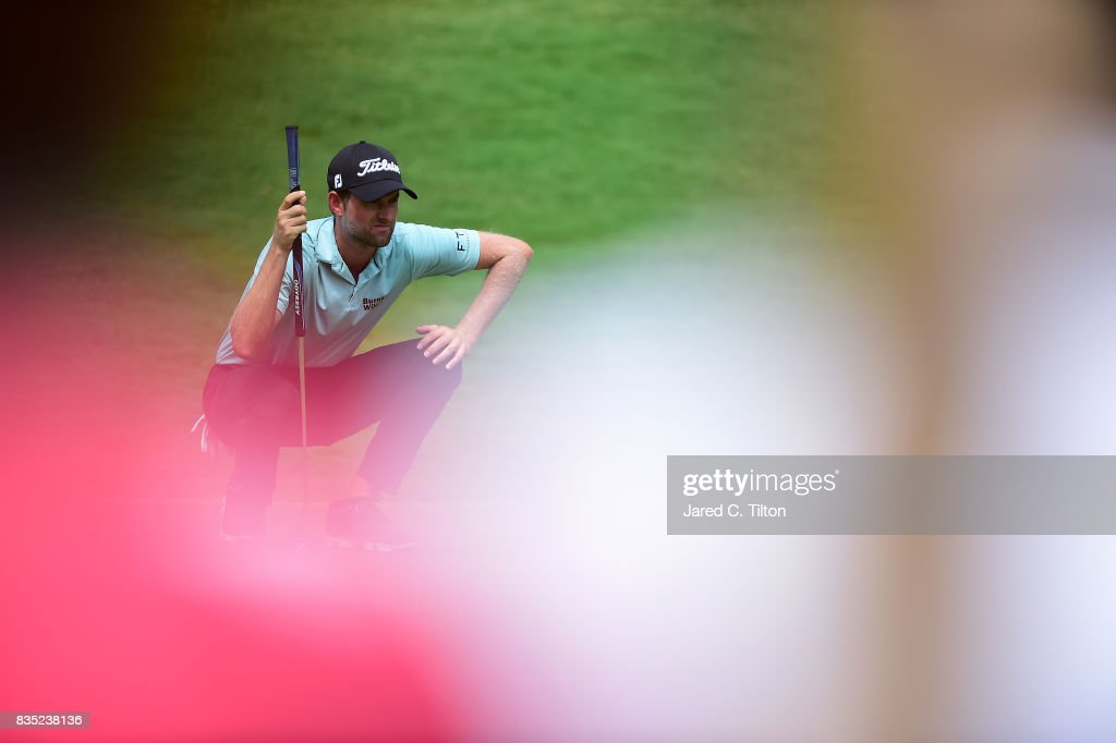 Webb Simpson lines up a putt on the eighth green during the second round of the Wyndham Championship at Sedgefield Country Club on August 18, 2017 in Greensboro, North Carolina.