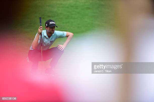 Webb Simpson lines up a putt on the eighth green during the second round of the Wyndham Championship at Sedgefield Country Club on August 18 2017 in...